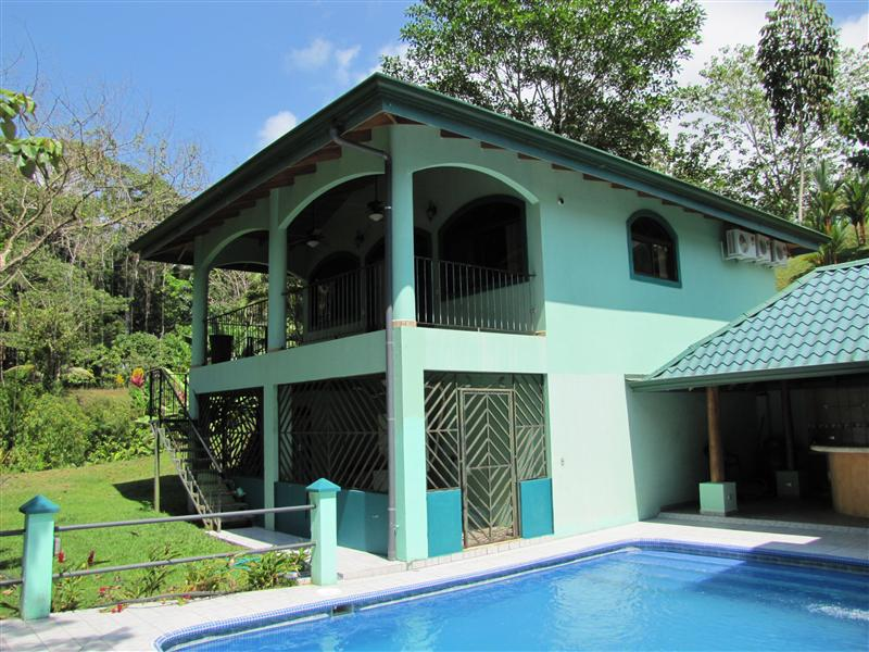 two story villas sit at the bottom of this 5 acre property
